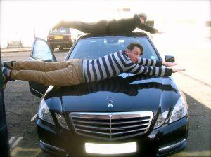 Lying on a car